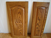Carved Emblem on Cabinet Door